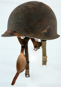 This helmet now resides in the December 44 Museum in La Gleize, Belgium. the helmet is significant for several reasons. First off, they only made 20 of them. It had special welds and strap arrangement for the radio operators. The insignia is that of a bird in flight, no doubt, a pigeon. The radio was replacing the pigeon as a communications means. Most don't realize this, but on D-Day, pigeons were still in use. See the video on the home page that shows us finding the helmet.
