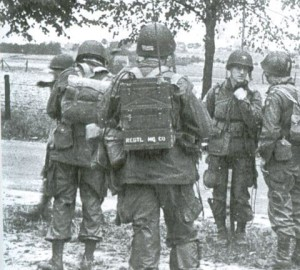 Ernie Blanchard, back to camera, wearing SCR300 radio pack. Taken in Market Garden action Nederlands