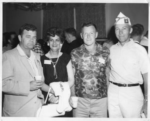 "L-R, Bob Machol, Mrs. ""Meme"" Machol, Ernie Blanchard, unknown officer."