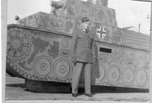 Not certain where taken. In front of dummy German tank.